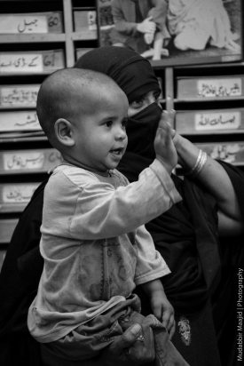 A child waves to Edhi