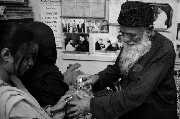 Edhi administering Polio Drop